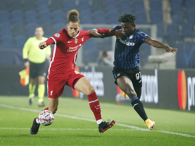 Atalanta BC's Duvan Zapata in action with Liverpool's Rhys Williams in the Champions League on November 3, 2020