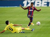 Barcelona's Ansu Fati in action with Villarreal's Dani Parejo in La Liga on September 27, 2020