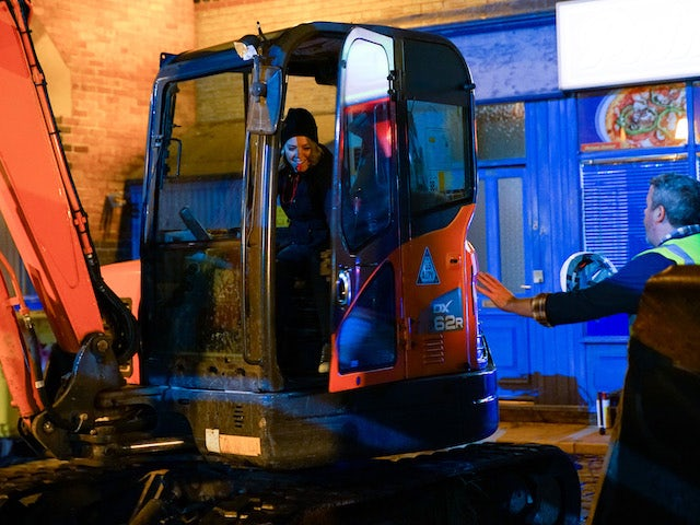 Abi boards the bulldozer on Coronation Street on December 9, 2020