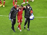 Bayern Munich's Joshua Kimmich is helped off after picking up an injury in November 2020