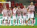 FC Koln players celebrate scoring against Union Berlin on November 22, 2020