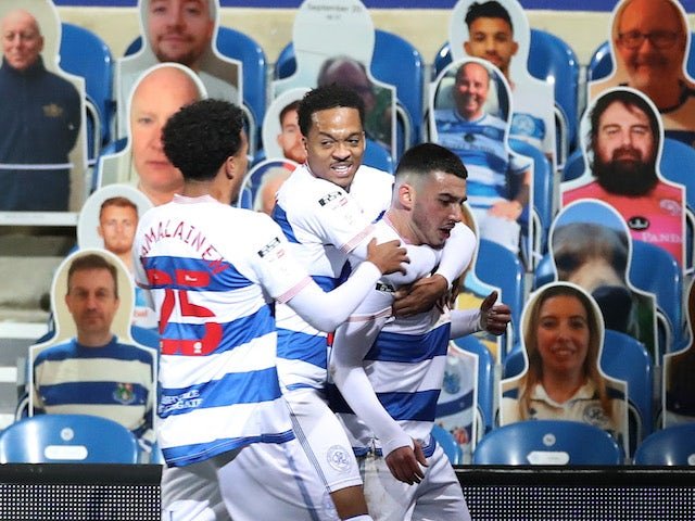 Queens Park Rangers' QPR's Ilias Chair celebrates scoring their first goal with teammates against Watford on November 21, 2020