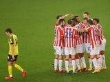 Stoke City's Sam Clucas celebrates scoring their fourth goal with teammates against Huddersfield Town on November 21, 2020