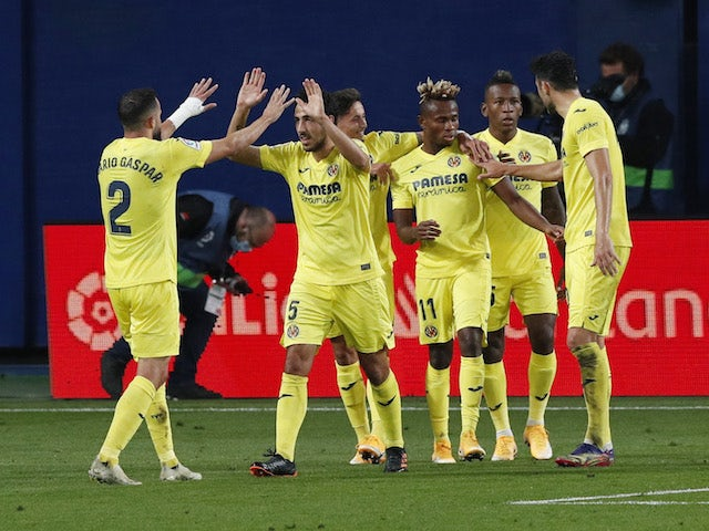 Villarreal's Gerard Moreno celebrates scoring their first goal with teammates against Real Madrid on November 21, 2020