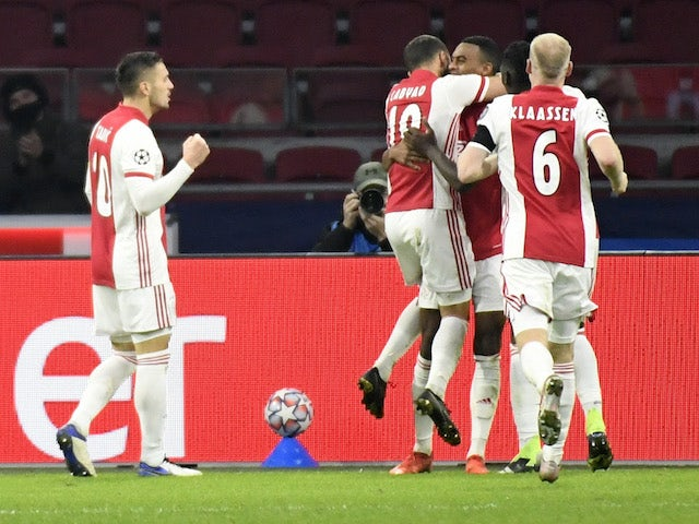 Ajax players celebrate scoring against FC Midtjylland on November 25, 2020
