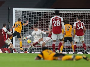 Jimenez suffers serious head injury as Wolves win at Arsenal