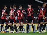 Junior Stanislas celebrates with teammates after scoring for Bournemouth against Nottingham Forest in the Championship on November 24, 2020