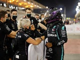 Lewis Hamilton celebrates after sealing pole position in qualifying for the Bahrain Grand Prix on November 28, 2020