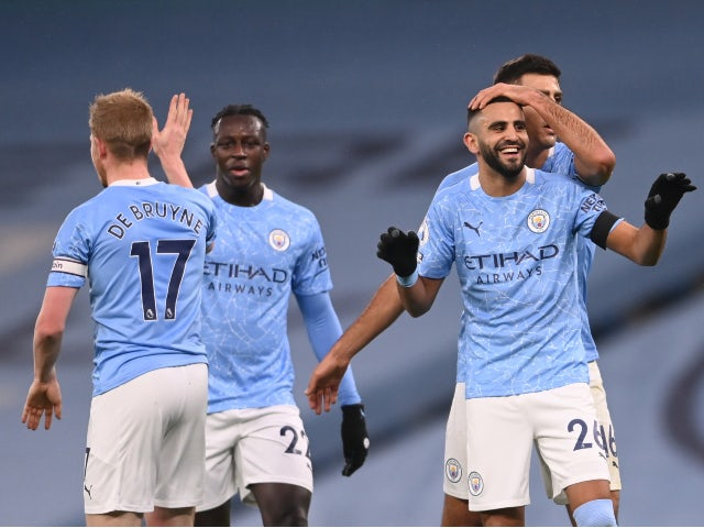 Riyad Mahrez celebrates with teammates after scoring for Manchester City against Burnley in the Premier League on November 28, 2020