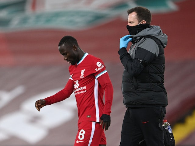 Liverpool midfielder Naby Keita walks off injured against Leicester City on November 22, 2020