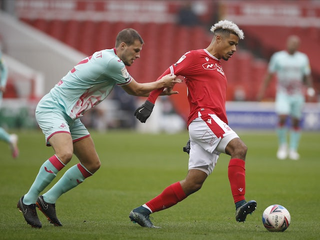 Nottingham Forest's Lyle Taylor in action with Swansea City's Ryan Bennett in the Championship on November 29, 2020
