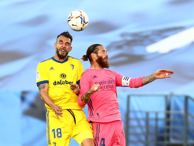 Real Madrid's Sergio Ramos in action with Cadiz's Alvaro Negredo in La Liga on October 17, 2020
