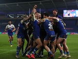 Jack Welsby celebrates his winning try against Wigan Warriors with St Helens teammates in the Super League Grand Final on November 27, 2020