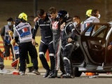 Romain Grosjean is helped away after his horror crash at the Bahrain Grand Prix on November 29, 2020