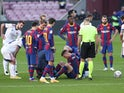 Barcelona's Clement Lenglet goes down injured against Osasuna in La Liga on November 29, 2020