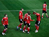 Callum Styles celebrates with teammates after scoring for Barnsley against Birmingham City in the Championship on December 1, 2020