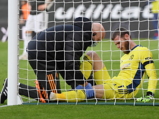 Manchester United goalkeeper David de Gea receives treatment for a knee injury against Southampton on November 29, 2020