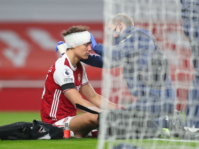 Arsenal's David Luiz is bandaged up following his clash of heads with Wolves' Raul Jimenez on November 29, 2020