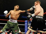 Amir Khan in action with Dmitry Salita in 2009