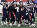 The New England Patriots celebrate a Nick Folk winning field goal against the Arizona Cardinals on November 29, 2020