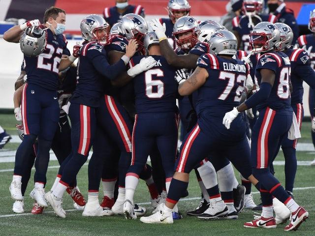 The New England Patriots celebrate a Nick Folk winning field goal against the Arizona Cardinals on November 29, 2020