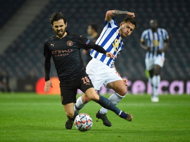 Porto's Otavio in action with Manchester City's Bernardo Silva in the Champions League on December 1, 2020