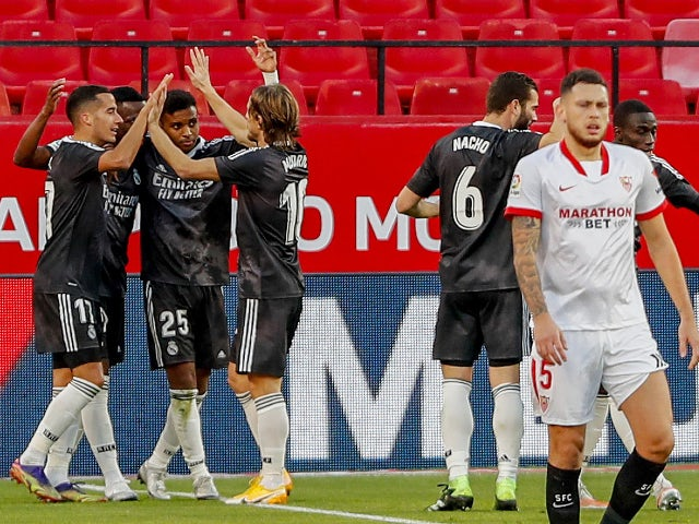 Real Madrid celebrate scoring against Sevilla in La Liga on December 5, 2020