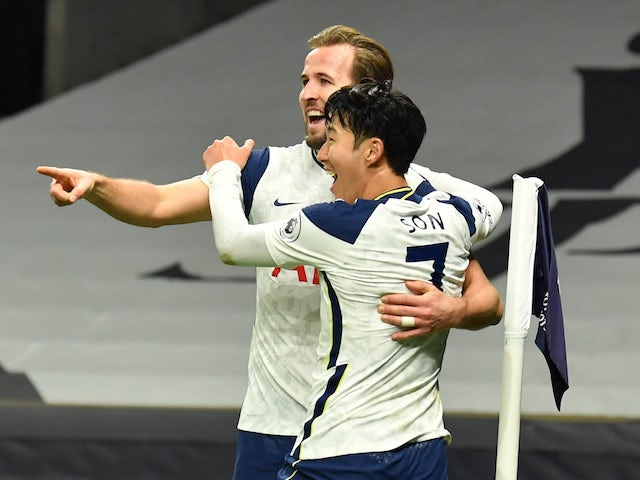 Tottenham Hotspur's Harry Kane celebrates with Son Heung-min after scoring against Arsenal in the Premier League on December 6, 2020