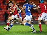 Wales' Kieran Hardy runs through to score their first try in the Autumn Nations Cup on December 5, 2020