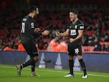 Burnley's Ashley Westwood and Dwight McNeil celebrate an own goal against Arsenal on December 13, 2020