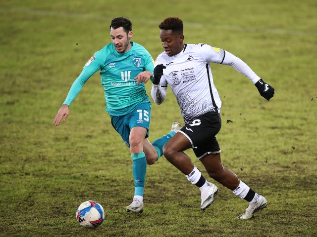 Swansea City's Jamal Lowe in action with Bournemouth's Adam Smith in the Championship on December 8, 2020