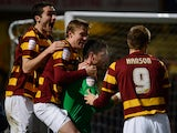 Bradford players celebrate beating Arsenal in the EFL Cup on December 11, 2012