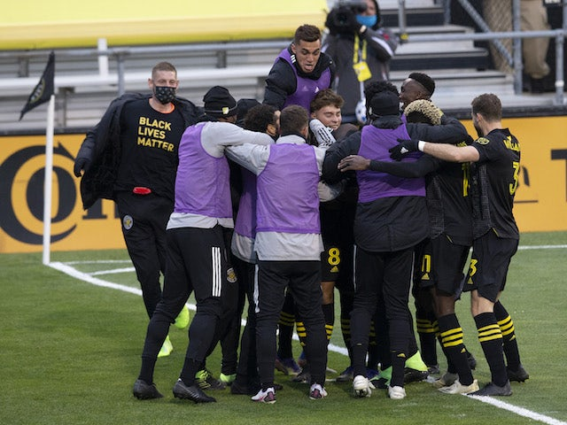 Columbus Crew players celebrate scoring against New England Revolution in December 2020