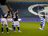 QPR players take a knee while Millwall players stand in the Championship on December 8, 2020
