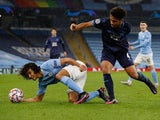 Manchester City's Nathan Ake in action with Marseille's Boubacar Kamara in the Champions League on December 9, 2020