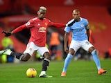 Manchester United's Paul Pogba in action with Manchester City's Fernandinho in the Premier League on December 12, 2020