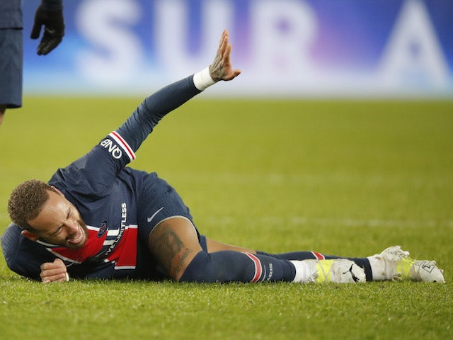 Paris Saint-Germain's Neymar reacts after sustaining an injury against Lyon in Ligue 1 on December 13, 2020