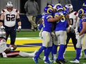 Los Angeles Rams defense celebrates after sacking New England Patriots quarterback Cam Newton on December 11, 2020