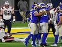 Los Angeles Rams defense celebrates after sacking New England Patriots quarterback Cam Newton on December 11, 2020