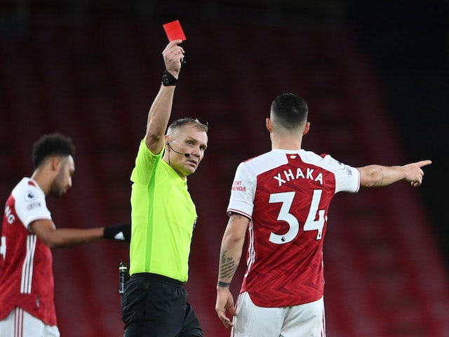 Arsenal's Granit Xhaka is shown a red card against Burnley on December 13, 2020