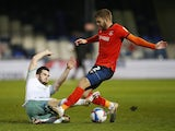 Bournemouth's Lewis Cook in action with Luton Town's Martin Cranie on December 19, 2020