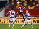 Brentford's Ivan Toney in action with Reading's Josh Laurent and Michael Morrison on December 19, 2020