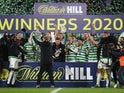 Celtic players and staff celebrate winning the Scottish Cup final on December 20, 2020