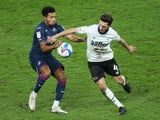 Derby County's Graeme Shinnie in action with Swansea City's Korey Smith in the Championship on December 16, 2020