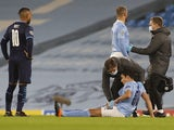 Manchester City defender Eric Garcia receives treatment for an injury in December 2020