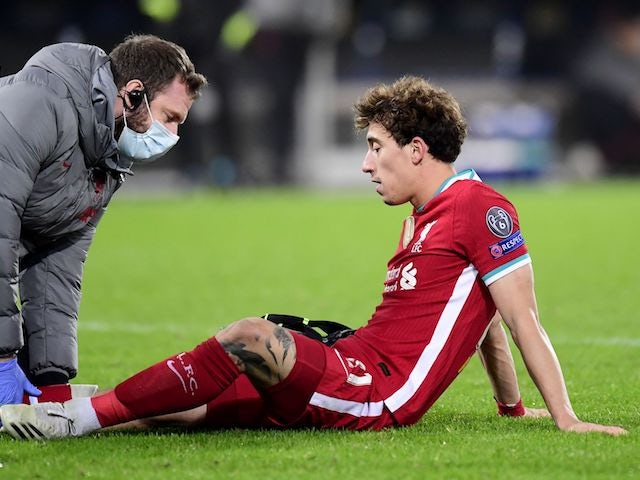 Liverpool's Kostas Konstantinos Tsimikas receives treatment for an injury in December 2020