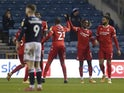 Nottingham Forest's Alex Mighten celebrates scoring their first goal with teammates against Millwall on December 19, 2020