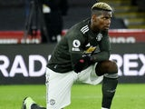 Manchester United's Paul Pogba takes the knee on December 17, 2020