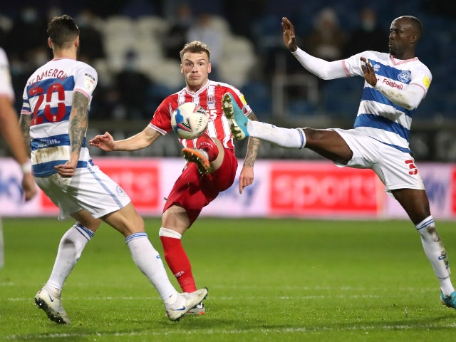 QPR's Albert Adomah in action with Stoke City's Josh Tymon in the Championship on December 15, 2020
