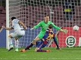 Valencia's Maxi Gomez scores their second goal against Barcelona on December 19, 2020